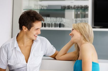 Signs of Attraction From Men - Man And Woman Laughing