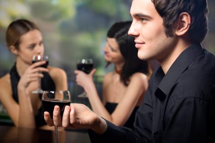 Get a guy to like you - Girls chatting in the background while guy drinks alone