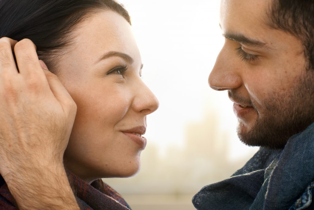 man looking into woman's eyes