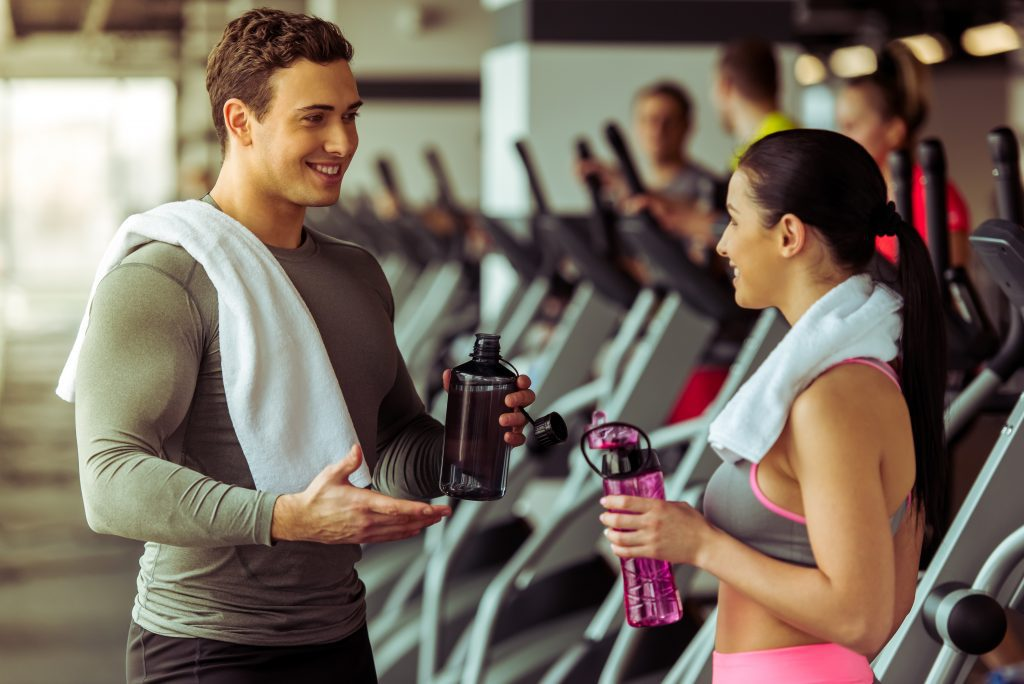man and woman talking at the gym