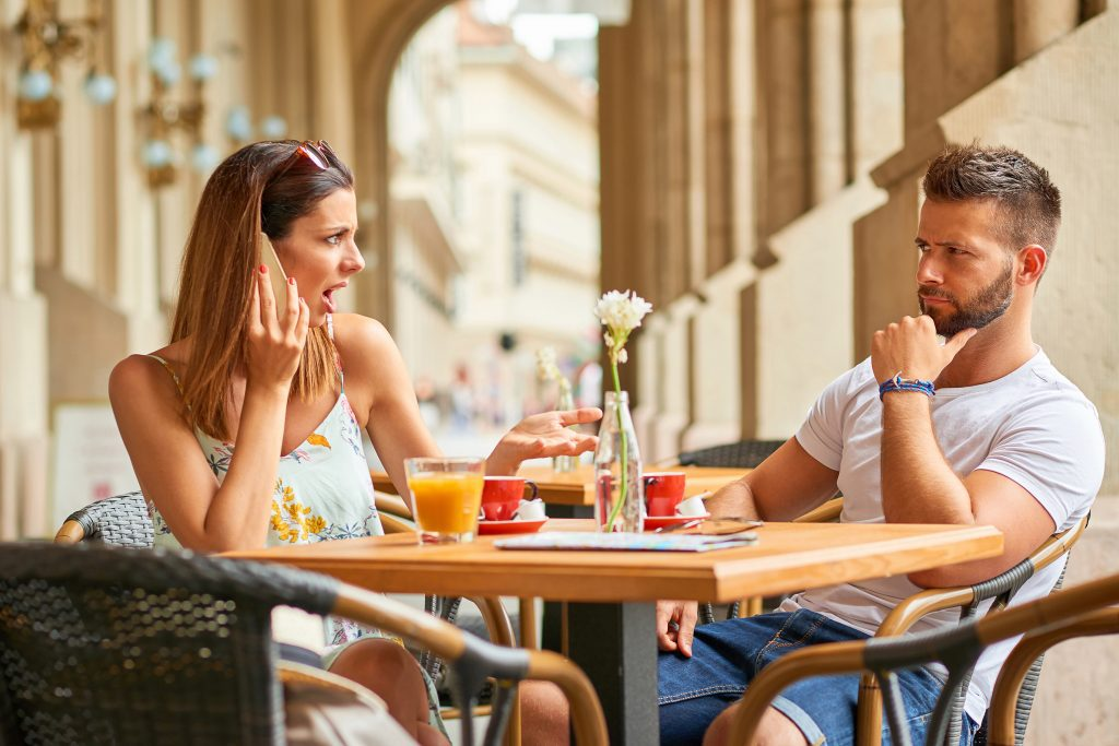 man unhappy with woman on date