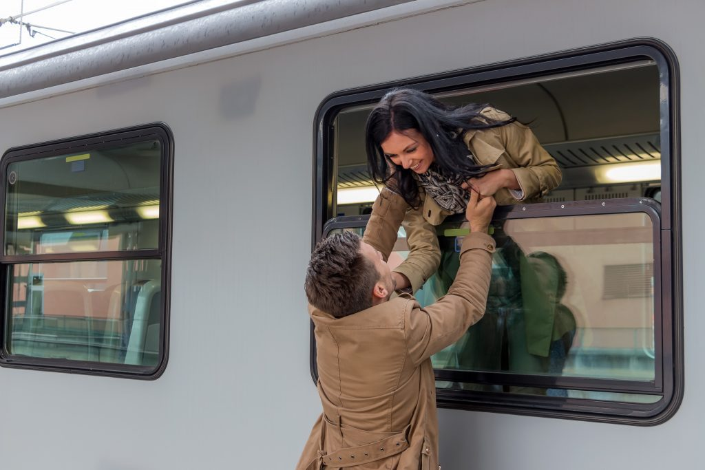 couple saying goodbye on train
