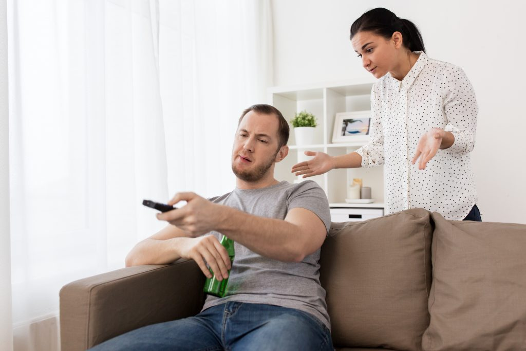 girlfriend annoyed with lazy man