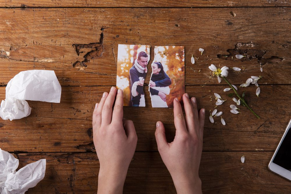 torn photo of couple
